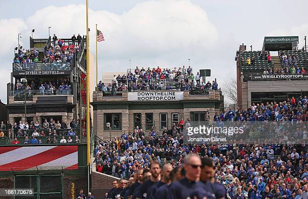 Fans on rooftops overlooking Wrigley Field watch the Opening Day action between the Chicago Cubs and the Milwaukee Brewers at Wrigley Field on April...
