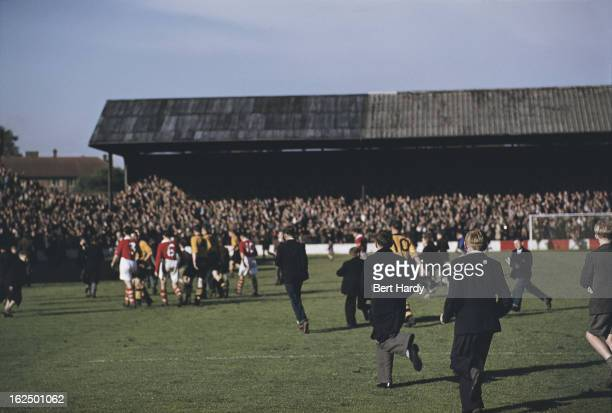 Fans on the pitch after a match between Charlton Athletic and Wolverhampton Wanderers at The Valley Charlton London 11th September 1954 Wolves won...