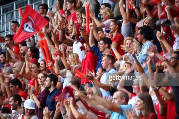 fans on the stadium cheering - fan enthusiast stock pictures, royalty-free photos & images