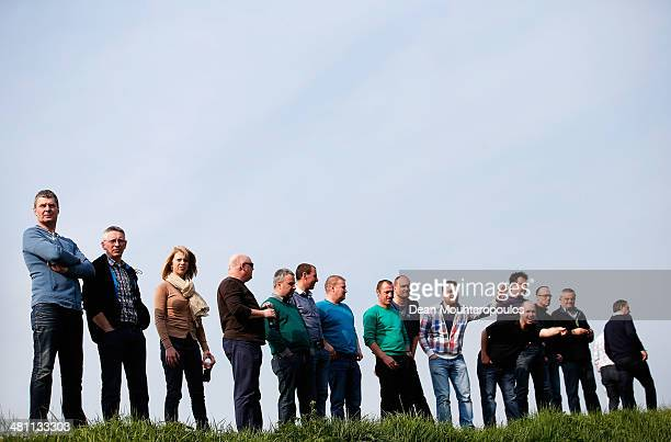 Fans on the streets cheer the riders on during the E3 Harelbeke Cycle Race on March 28, 2014 in Harelbeke, Belgium.