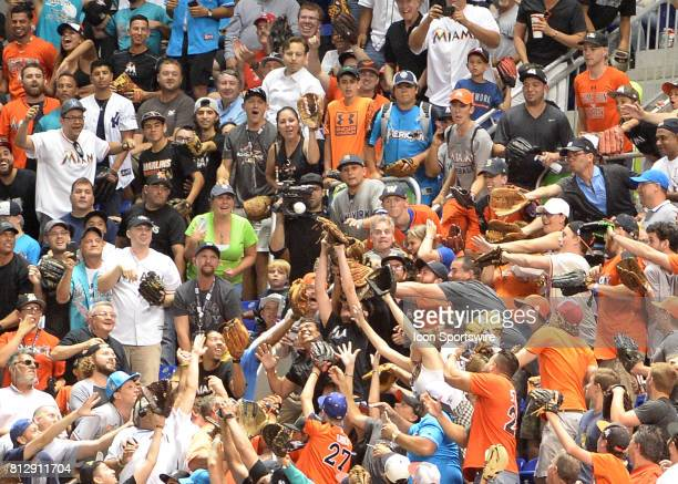 Fans on the upper deck at Marlins Parkt trying to catch a Home Run by Los Angeles Dodgers outfielder Cody Bellinger during the Home Run Derby on July...