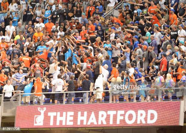 Fans on the upper deck at Marlins Parkt trying to catch a Home Run during the Home Run Derby on July 09 2017 at Marlins Park in Miami FL
