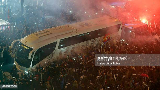Fans outside the ground welcome the Real Madrid team as they arrive by bus prior the Copa del Rey round of 16 second leg match between Real Madrid CF...