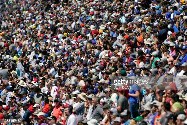 Fans pack into the Indianapolis 500 auto race at Indianapolis Motor Speedway, May 30, 2021 in Indianapolis. - Brazil's Helio Castroneves matched the...