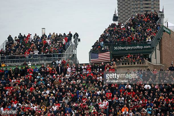 Fans pack the bleechers and rooftops for the NHL Winter Classic between the Chicago Blackhawks and the Detroit Red Wings at Wrigley Field on January...
