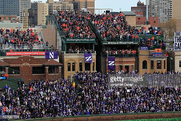 Fans pack the right field bleachers and the roof tops to watch as the Northwestern Wildcats take on the Illinois Fighting Illini during a game played...