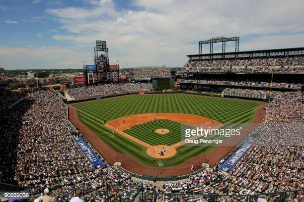 48704 fans pack the stadium as the San Francisco Giants face the Colorado Rockies at Coors Field on August 23 2009 in Denver Colorado The Rockies...