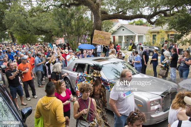 Fans parade down Poland Avenue toward the former home of music legend Antoine 'Fats' Domino during a second line parade honoring him on November 1...