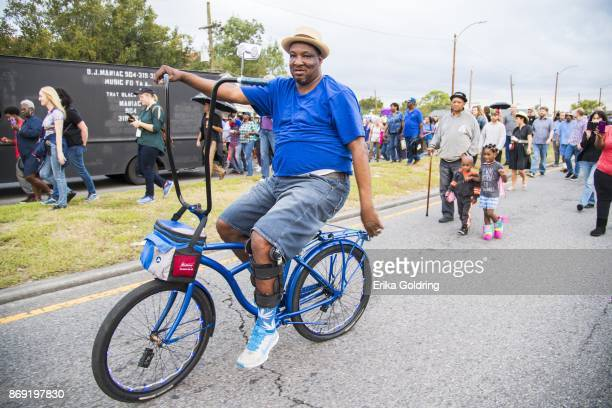 Fans parade down St Claude Avenue toward the former home of music legend Antoine 'Fats' Domino during a second line parade honoring him on November 1...