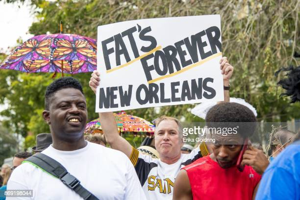 Fans parade on Dauphine Street toward the former home of music legend Antoine 'Fats' Domino during a second line honoring him on November 1 2017 in...