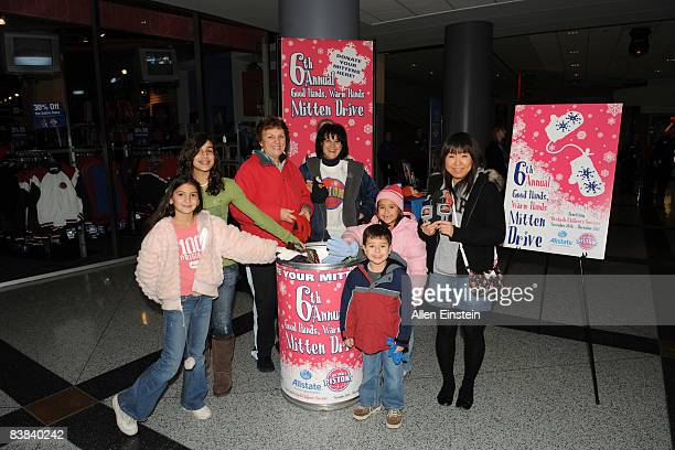 Fans participate in a Mitten Drive sponsored by the Pistons and Allstate Insurance Company called Good Hands Warm Hands before a game featuring the...