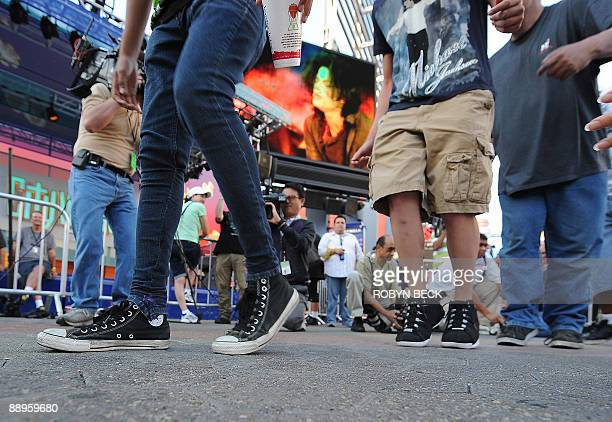 Fans participate in a moonwalk contest at a oneday tribute to the King of Pop which included outdoor screenings of The Wiz and Thriller at Universal...