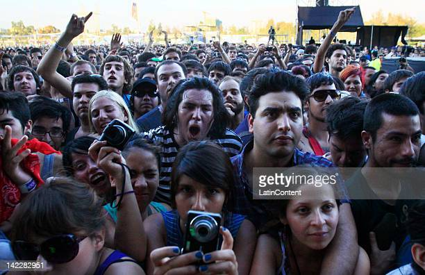 Fans participate in the Lollapalooza music festival at O Higgins Park on March 31 2012 in Santiago Chile