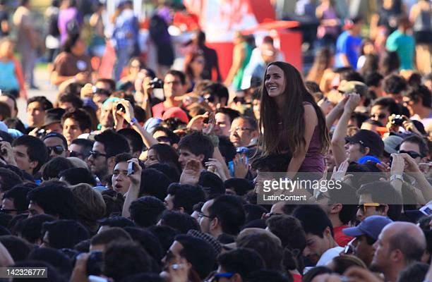Fans participate in the Lollapalooza music festival at O Higgins Park on April 1 2012 in Santiago Chile
