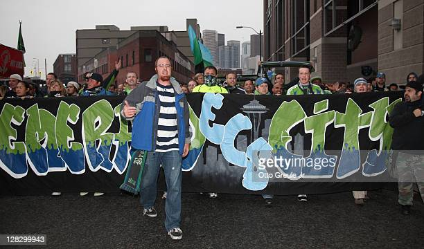 Fans participate in the March to the Match prior to the match between the Seattle Sounders FC and the Chicago Fire in the 2011 Lamar Hunt US Open Cup...