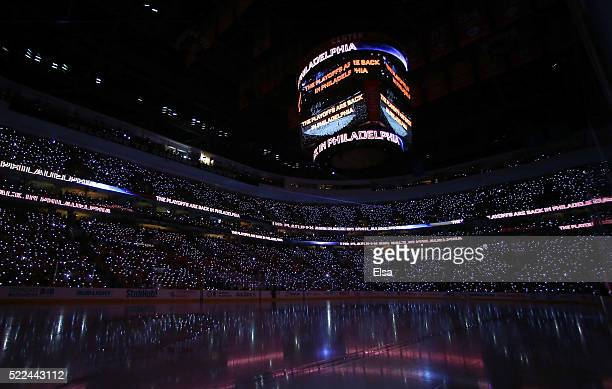 Fans participate in the pregame show with lighted wristbands before the game between the Philadelphia Flyers and the Washington Capitals in Game...