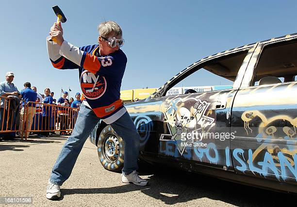 Fans participate in the Smash Car event during the Fan Fest prior to the game between the New York Islanders and the Pittsburgh Penguins in Game...