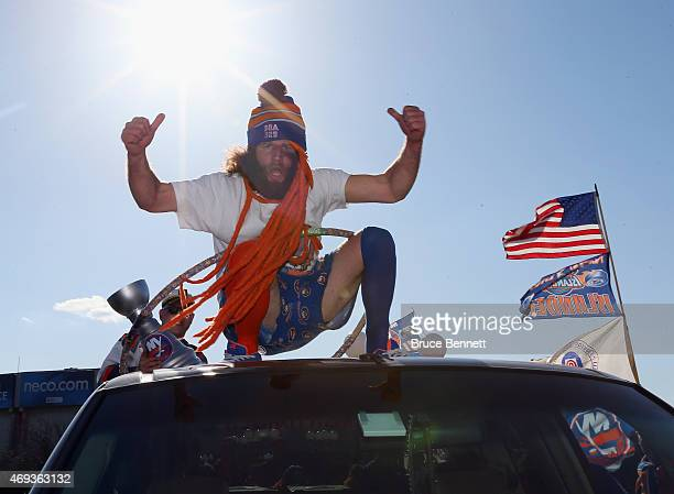 Fans party in the parking lot prior to the game against the Columbus Blue Jackets at the Nassau Veterans Memorial Coliseum on April 11, 2015 in...