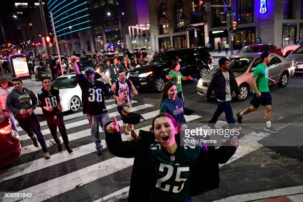 Fans pass on North Broad Street reacting to the Eagles' win near City Hall on January 21 2018 in Philadelphia Pennsylvania The Philadelphia Eagles...