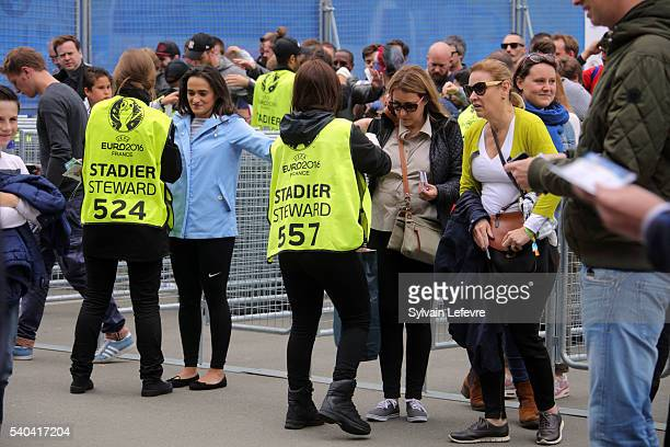 Fans pass through a security check before entering the stadium for the UEFA EURO 2016 Group B match between Russia and Slovakia at Stade PierreMauroy...