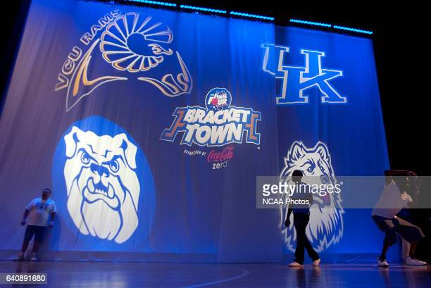 Fans pause at the entrance of the NCAA Photos via Getty Images Bracket Town presented by CocaCola Zero to take pictures during the 2011 NCAA Photos...