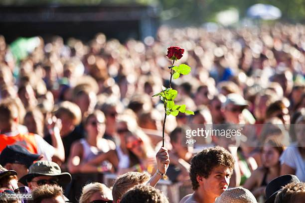 Fans pay their respect as American rock legend Patti Smith performs in Roskilde on July 1 2010 in memory of the nine people who passed away ten years...