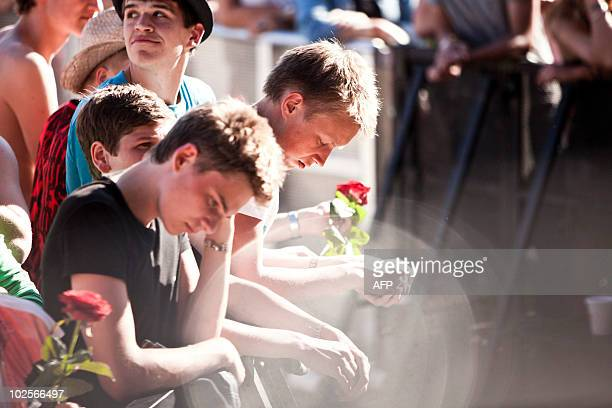 Fans pay their respect prior to American rock legend Patti Smith performance in Roskilde on July 1 2010 in memory of the nine people who passed away...