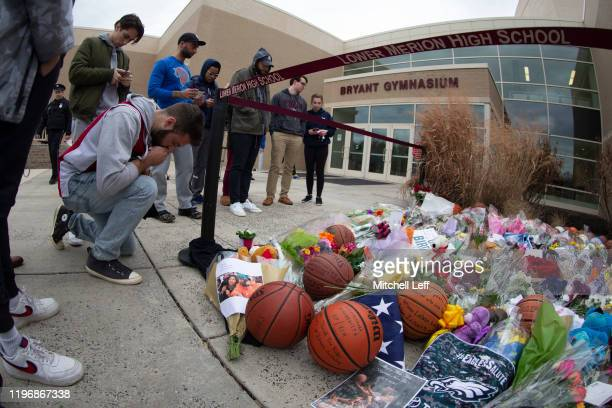 Fans pay their respects at a memorial for former Los Angeles Laker Kobe Bryant after he was killed in a helicopter crash at Lower Merion High School...