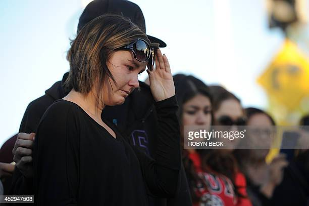 Fans pay their respects at the site of the car accident in which actor Paul Walker was killed in Santa Clarita California on December 1 2013 Fans and...