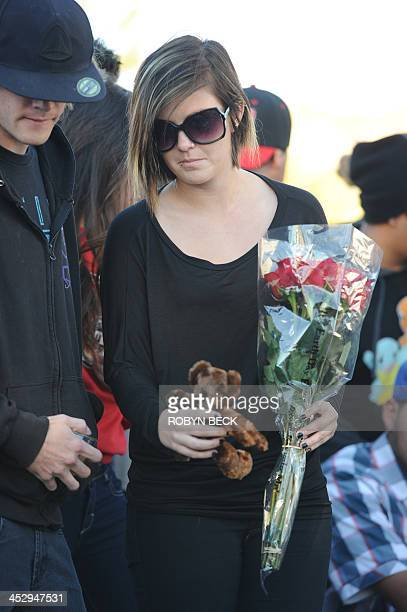 Fans pay their respects at the site of the car accident in which actor Paul Walker was killed in Santa Clarita, California, on December 1, 2013. Fans...