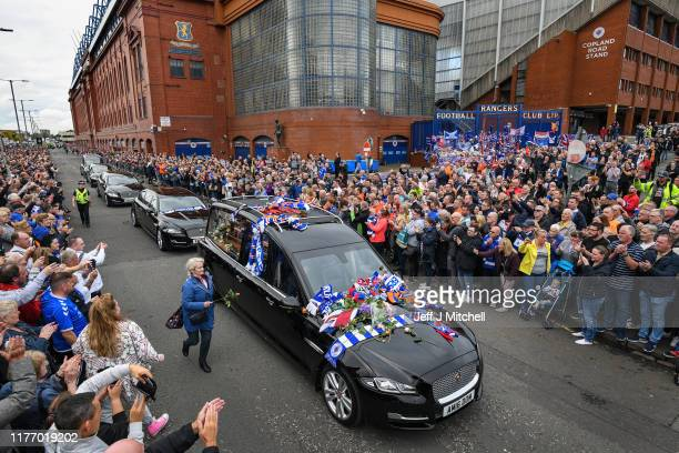 Fans pay their respects to former Rangers player Fernando Ricksen as his funeral cortege makes its way past Ibrox Stadium, along Paisley Road West on...