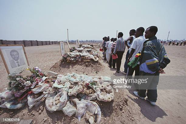 Fans pay their respects to the graves of the Zambian national football team members killed in an aircrash on 12th July 1993 in Heroes Acre outside...