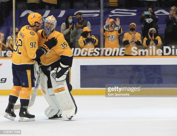 Fans pay tribute as Nashville Predators center Ryan Johansen congratulates goalie Pekka Rinne , of Finland, at the conclusion of the NHL game between...