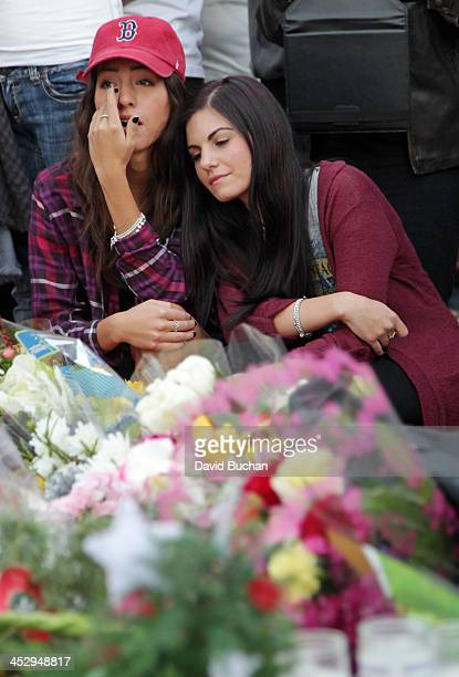Fans pay tribute to actor Paul Walker at the site of his fatal car accident on December 1 2013 in Valencia California Walker died on November 30 2013...