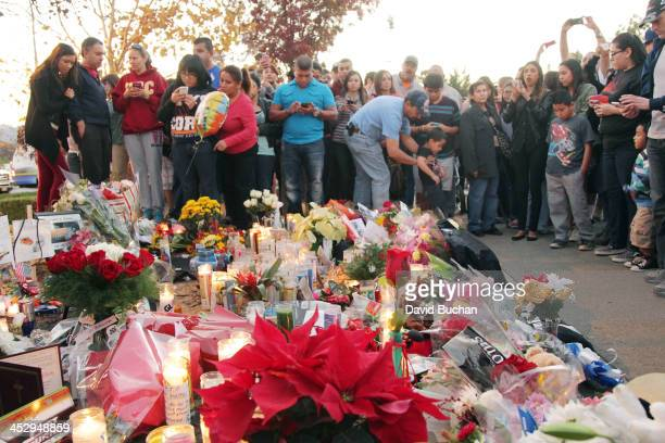 Fans pay tribute to actor Paul Walker at the site of his fatal car accident on December 1, 2013 in Valencia, California. Walker died on November 30,...