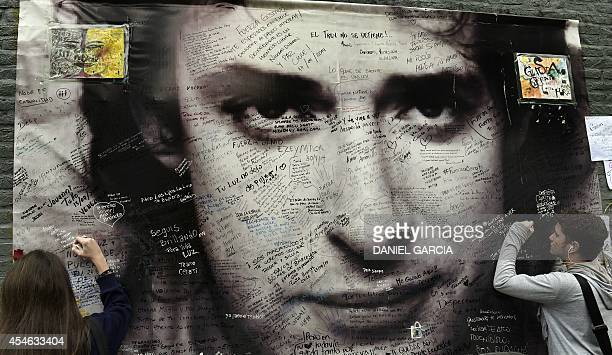 Fans pay tribute to Argentine musician Gustavo Cerati in front of the clinic where he died from a stroke on September 4 2014 in Buenos Aires On May...