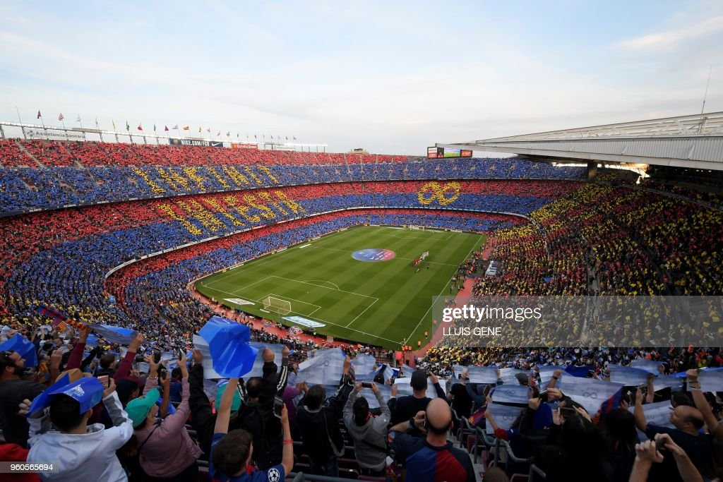 Fans pay tribute to Barcelona's Spanish midfielder Andres Iniesta before the Spanish league football match between FC Barcelona and Real Sociedad at the Camp Nou stadium in Barcelona on May 20, 2018.