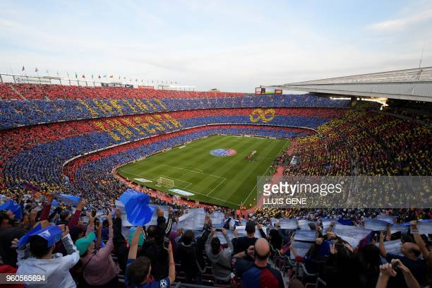 Fans pay tribute to Barcelona's Spanish midfielder Andres Iniesta before the Spanish league football match between FC Barcelona and Real Sociedad at...