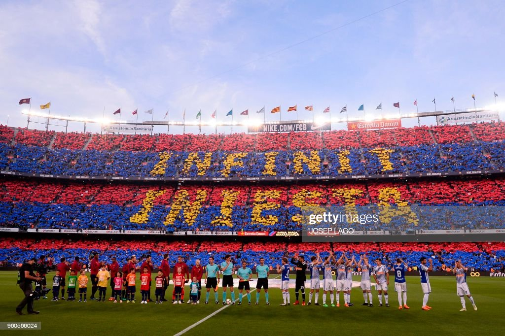 TOPSHOT - Fans pay tribute to Barcelona's Spanish midfielder Andres Iniesta before the Spanish league football match between FC Barcelona and Real Sociedad at the Camp Nou stadium in Barcelona on May 20, 2018.