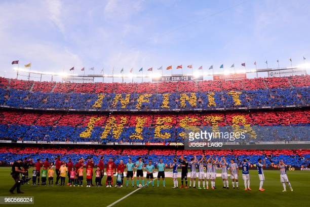 TOPSHOT Fans pay tribute to Barcelona's Spanish midfielder Andres Iniesta before the Spanish league football match between FC Barcelona and Real...