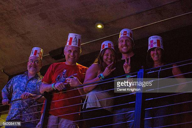 Fans pay tribute to Buckethead by wearing their own KFC chicken buckets on their heads at a Buckethead concert at Music Box on June 21 2016 in San...