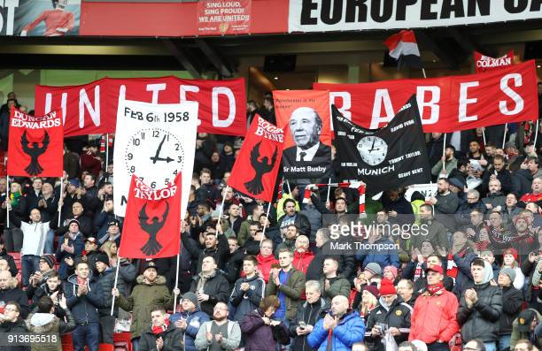 Fans pay tribute to the Manchester United team that were involved in the Munich disaster prior to the Premier League match between Manchester United...