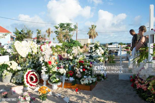 Fans pays their respects at the tomb of late French music icon Johnny Hallyday on the French Caribbean island of SaintBarthelemy on December 12 a day...
