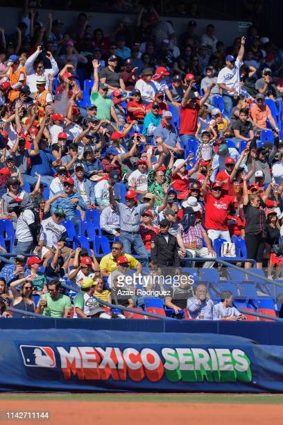 Fans perform a wave during the second game of the Mexico Series between the Cincinnati Reds and the St. Louis Cardinals at Estadio de Beisbol...