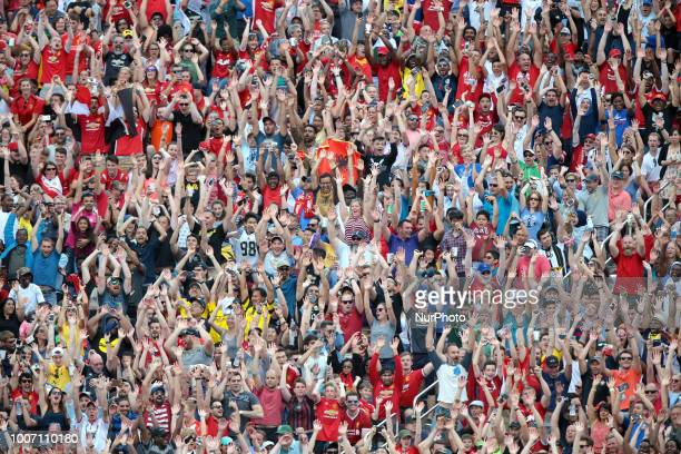 Fans perform the wave during an International Champions Cup match between Manchester United and Liverpool at Michigan Stadium in Ann Arbor Michigan...
