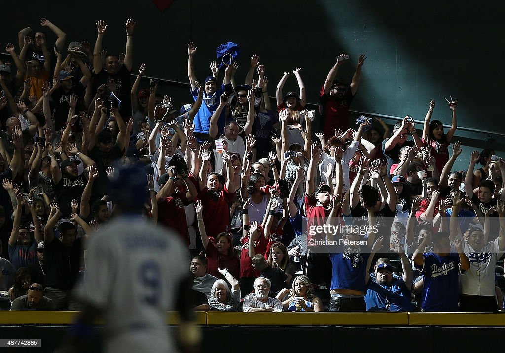 Fans perform the 'wave' during the MLB game between the Arizona Diamondbacks and the Los Angeles Dodgers at Chase Field on April 13, 2014 in Phoenix, Arizona. The Dodgers defeated the Diamondbacks 8-6.