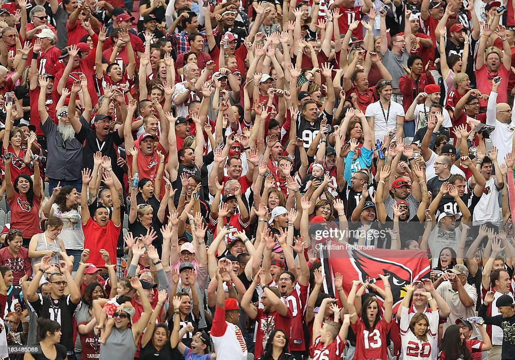 Fans perform the wave during the NFL game between the Arizona Cardinals and the Carolina Panthers at the University of Phoenix Stadium on October 6, 2013 in Glendale, Arizona. The Cardinals defeated the Panthers 22-6.