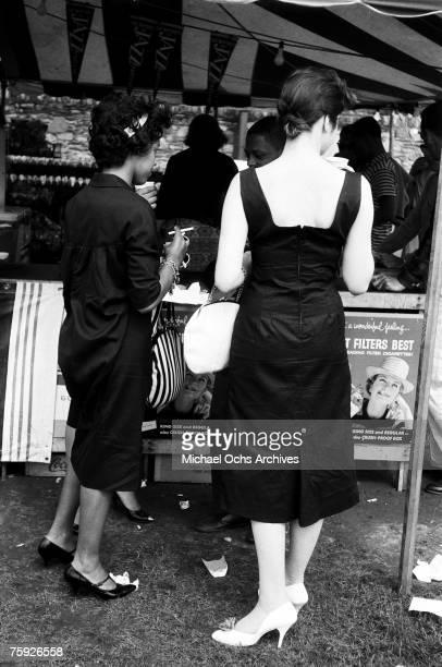 Fans peruse trinkets at the American Jazz Festival in July 1958 in Newport, Rhode Island.