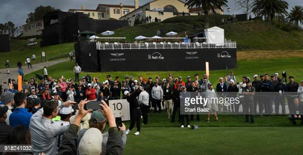 Fans photograph Tiger Woods on the tenth hole during the ProAm round for the Genesis Open at Riviera Country Club on February 14 2018 in Pacific...