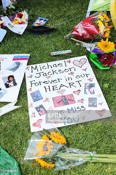 Fans place flowers at the grave of Michael Jackson to commemorate the 4th anniversary of his death at Forest Lawn Cemetery on June 25 2013 in Los...